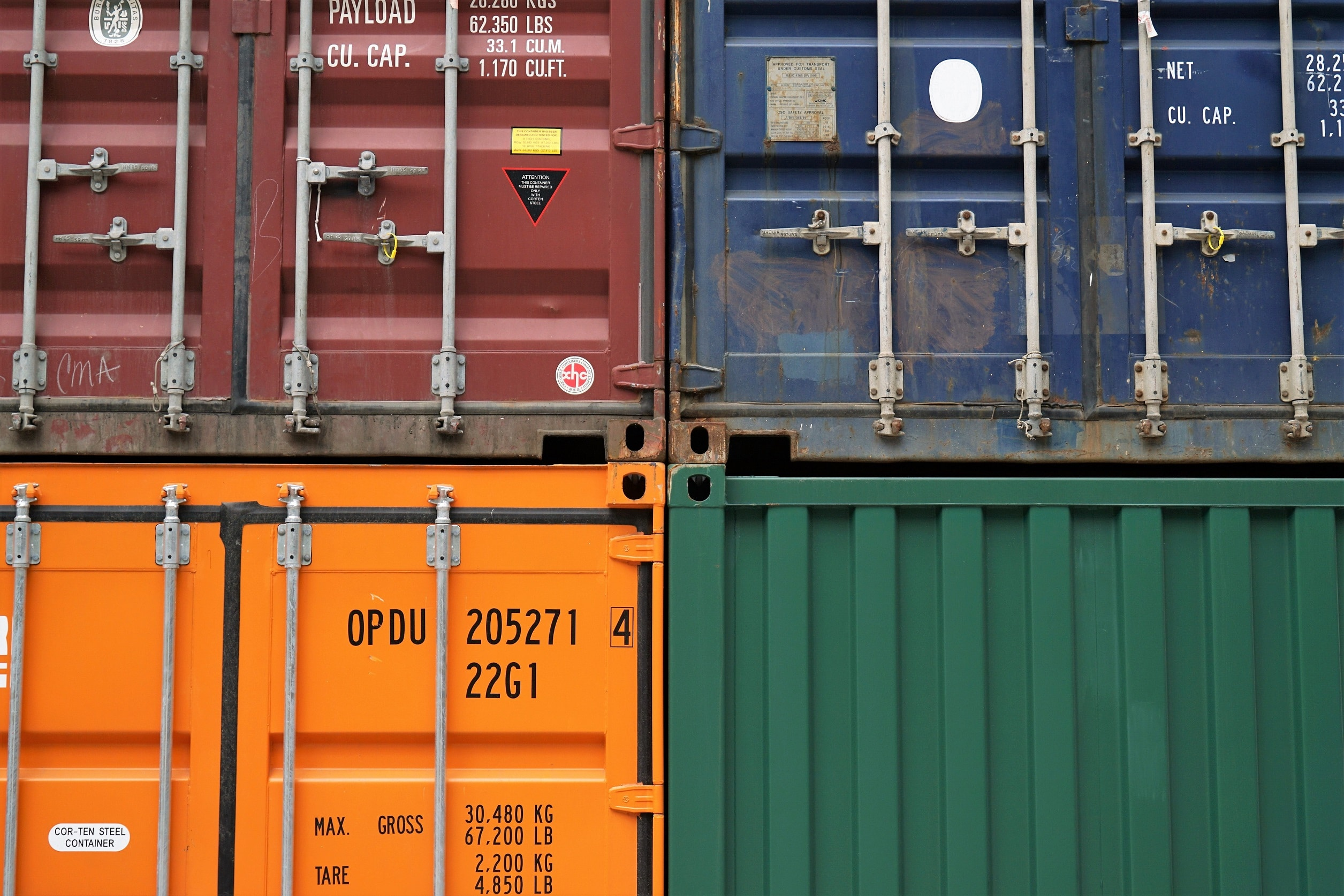 four container crates in blue, brown orange and green.